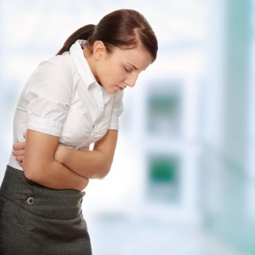 RS5211_sy_business_woman_with_stomach_issues_sh_76349143_clean_2015-lpr
